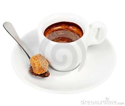 Coffee on a saucer and a spoon with