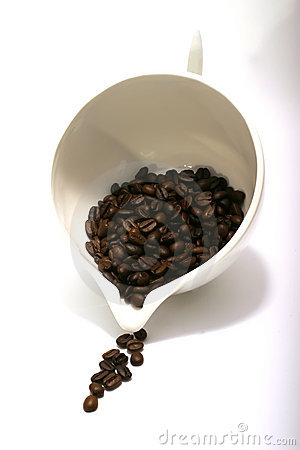 Coffee seeds flow from bowl