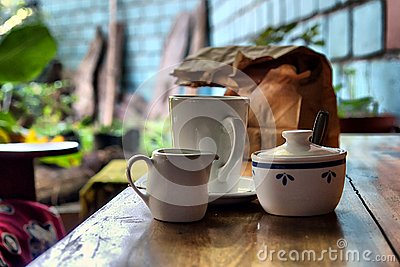 Coffee set and paper pack on table