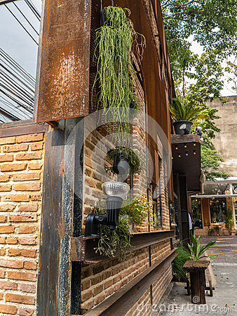 Coffee shop building outdoor decorate with plants.
