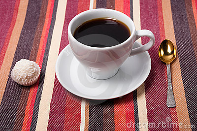 A coffee on a striped tablecloth
