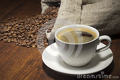 Coffee in table with a beans