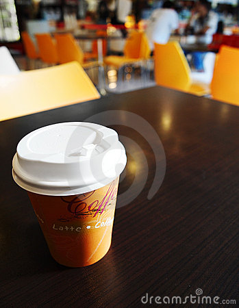 Free Coffee Takeout Cup On Campus Cafe Table Stock Photos - 13703453