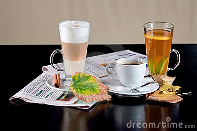Coffee, tea, latte with dry leaves and newspapers