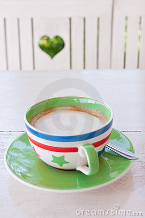 Coffee time in green garden with heart