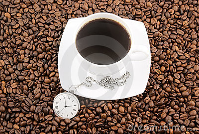 Coffee time, watch and cup on grains