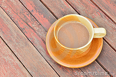 Coffee on vintage wood table