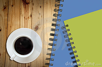 Coffee and white sketch book on wood ta