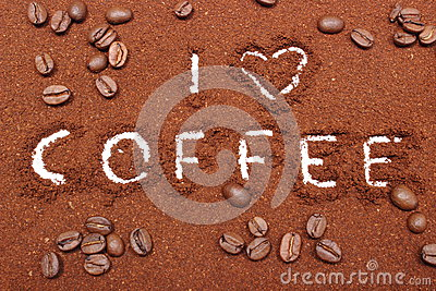 Coffee word written on ground coffee and grains