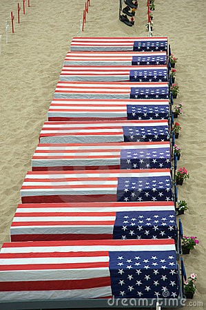 Coffins covered with American flags