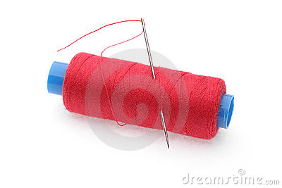 The coil of red threads with needle