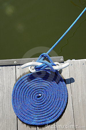Coil of rope by water