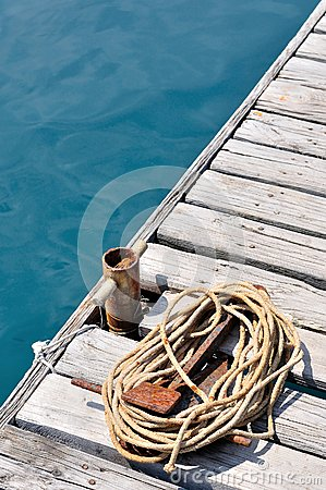 Free Coiled Marine Rope On Wooden Pier Stock Photo - 32499580