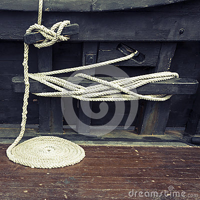 Free Coiled Maritime Rope On Wooden Deck Stock Images - 62583674