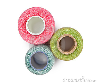 Coils with multi-coloured sewing threads isolated