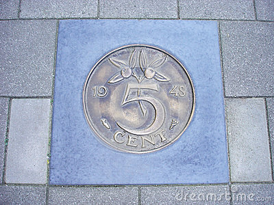 Coin of five cents in pavement