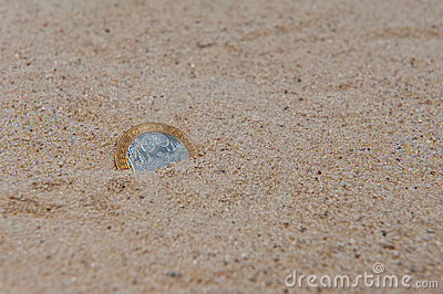 Coin in the sand