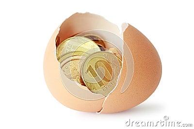 Coins in broken eggshell