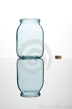 Coins and empty glass jar