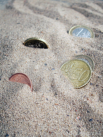 Free Coins In Sand Royalty Free Stock Photography - 3504097