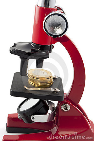 Coins and microscope