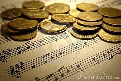 Coins on a musical notebook