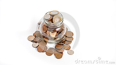 Coins overflowing from money jar