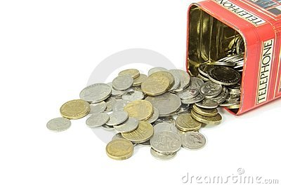 Coins spilling out of money box