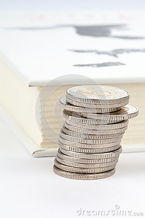 Coins and white book