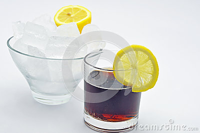 Cola with slice of lemon bowl of ice