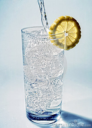Cold fresh mineral water poured into a glass