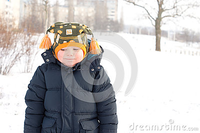 Cold little boy in winter snow