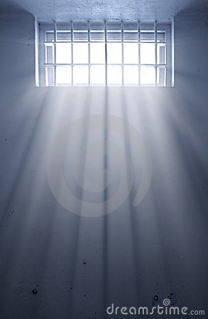 Cold prison cell with sunshine through window