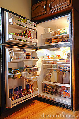 Cold Refrigerator Full of Fresh Food and Groceries