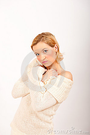 Cold sexy winter woman in white knit clothes