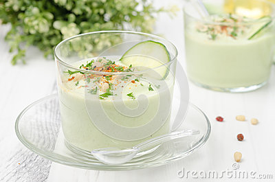 Cold soup with avocado, cucumber and yogurt in a glass beaker