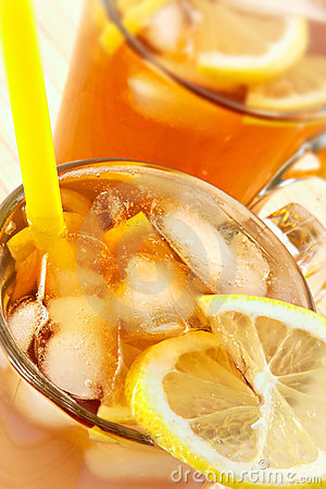 Cold tea with cubes of an ice and a lemon