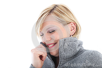 Cold woman cuddling into her jacket