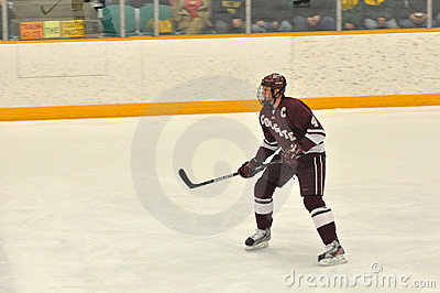 Colgate player in NCAA Ice Hockey Game Editorial Stock Image