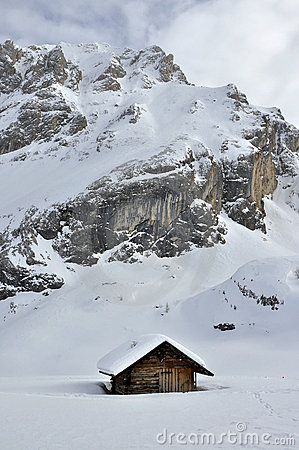 Collac peak and hut in winter, dolomites