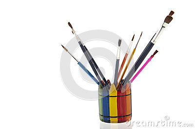 Collage of paintbrushes in a colourfull cup