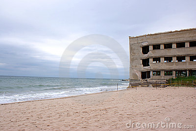 Collapsed building on the seaside