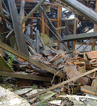 Collapsed roof showing wood glass,and stone rubble