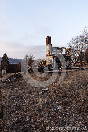 Free Collapsing, Abandoned House On Barren Street At Sunset Royalty Free Stock Images - 99048729
