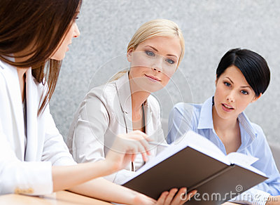 Colleagues discuss business plan