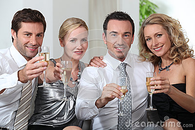 Colleagues drinking champagne