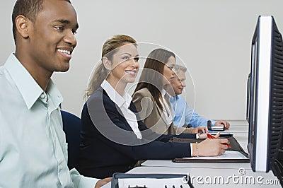 Colleagues Working In Computer Room
