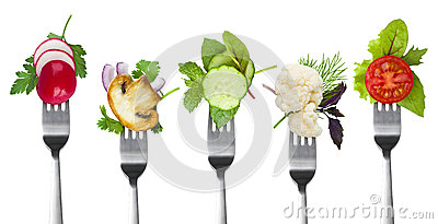 Collection of forks with herbs and vegetables isolated on white Stock Photo