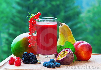 A collection of a fruit and a smoothie