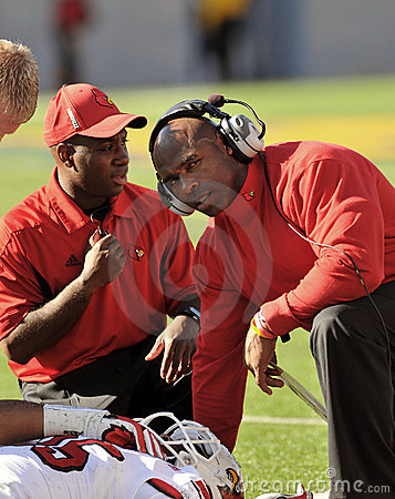 College football - coach with injured player Editorial Image